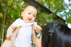 Asian mother and baby in the park Royalty Free Stock Photos