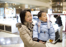 Asian mother and baby son at a shopping mall Stock Photography
