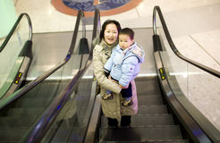 Asian mother and baby son at a shopping mall Royalty Free Stock Images