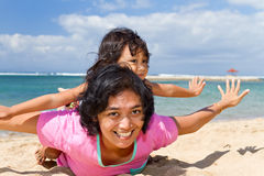 Asian mother and child playing at the beach Stock Images