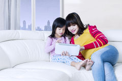 Asian mother and child use tablet in apartment Stock Images