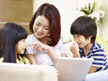 Asian mother and children having fun at home Royalty Free Stock Photography