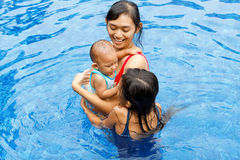 Asian mother and children swim together Royalty Free Stock Photography