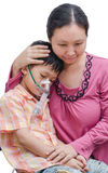 Asian mother comforts her son Stock Photos