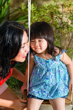 Asian Mother and daughter at home in garden Stock Image