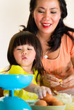 Asian Mother and daughter at home in kitchen Stock Photo