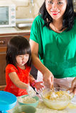 Asian Mother and daughter at home in kitchen Royalty Free Stock Photography