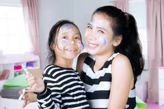 Asian mother and daughter with painted face Royalty Free Stock Photography