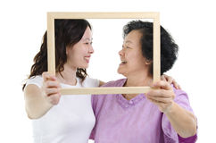 Asian mother and daughter photo frame Royalty Free Stock Images