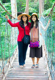 Asian mother and daughter standing on wooden hanging bridge in f Stock Photography