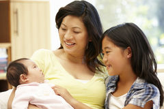 Asian mother and daughters Stock Image