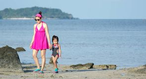 Asian Mother and female toddler child while walking in a beach resort stock images