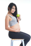 Asian mother-Green apple. Asian pregnant holding the green apple in her hand on white isolate back ground Royalty Free Stock Photography