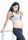 Asian mother-Green apple. Asian pregnant holding the green apple in her hand on white isolate back ground Royalty Free Stock Images