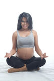 Asian mother-Green apple. Asian pregnant woman siting on white isolate back ground Royalty Free Stock Images
