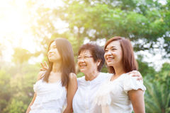 Asian mother and grown daughters Stock Photos