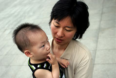 Asian mother and her baby Stock Photos