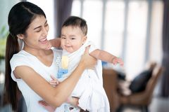Asian mother and her baby play togather stock image