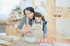 Asian mother and her daughter are preparing the dough Royalty Free Stock Photography