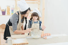 Asian mother and her daughter are preparing the dough Stock Photo