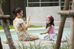 Asian mother and her daughter Stock Photos