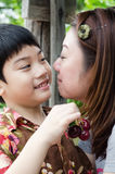 Asian mother with her son cherry on hand Stock Images