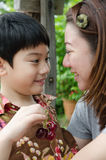 Asian mother with her son cherry on hand Royalty Free Stock Images