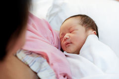 Asian mother with newborn baby in the hospital Royalty Free Stock Image
