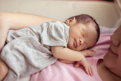 Asian mother with newborn baby in the hospital.  Royalty Free Stock Image