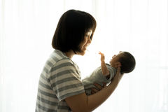 Asian mother with newborn baby in the hospital. SONy A7-24 mp Royalty Free Stock Photos