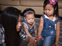 Asian mother painting daughters nails Royalty Free Stock Photography