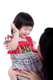 Asian mother playing her adorable little daughter, on white. Stu Royalty Free Stock Images