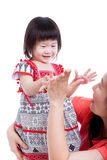 Asian mother playing her adorable little daughter, on white. Stu Royalty Free Stock Photo