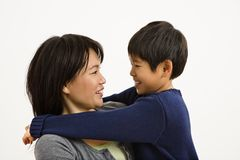 Asian mother and son. Hugging and smiling Stock Photography