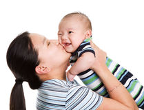 Asian mother and son. An isolated shot of an asian mother kissing her baby son Stock Image