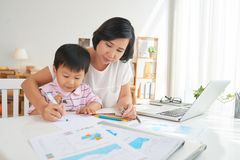 Drawing together. Asian mother and son drawing at workplace Stock Photo