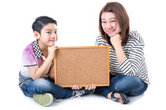 Asian mother and son hold wood board on white background Stock Image