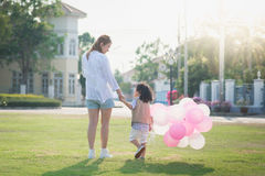 Asian mother and son holding hand together and walking Royalty Free Stock Images