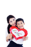 Asian mother and son holding love card - isolated Royalty Free Stock Photo