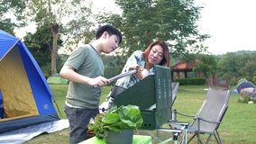 Asian mother and son are making barbecue for dinner. stock video