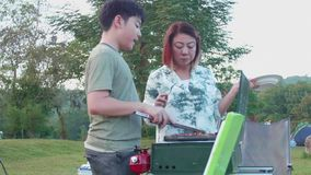 Asian mother and son are making barbecue for dinner. stock video footage