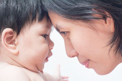 Asian mother and son stare each other to show their love for eac. H other Stock Photo