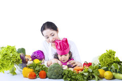 Asian mother teach daughter cook - isolated Royalty Free Stock Photography