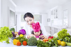Asian mother teach daughter cook at home Stock Image