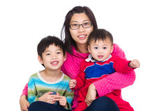 Asian mother with two son. Isolated on white Stock Image