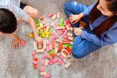 Free Asian Mother Work Home Together With Son. Mom And Kid Play Color Wooden Block. Child Creating Building Toy. Stock Photo - 191038300