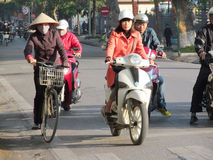 Asian motorbike and bicycle traffic on the street royalty free stock photography