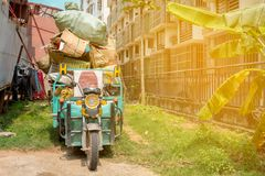 Asian motorcycle with cargo in Asian City Royalty Free Stock Photo