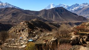 Asian mountain village and terrace fields in autumn in Lower Mustang, Nepal, Himalaya, Annapurna Conservation Area.  royalty free stock image