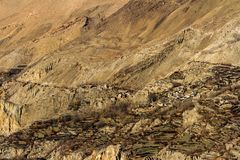 Asian mountain village and terrace fields in autumn in Lower Mustang, Nepal, Himalaya. Asian mountain village and terrace fields in autumn in Lower Mustang royalty free stock images